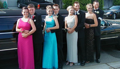 Teens Standing in front of a Limousine